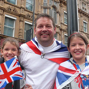 An image of Angus and his two daughters