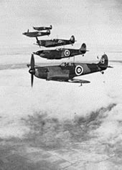 A photo of 4 spitfires in formation