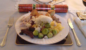 A photo of a full christmas dinner