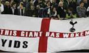 Tottenham fans with a flag