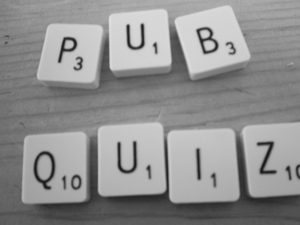 A photo of scrabble letters spelling 'pub quiz'