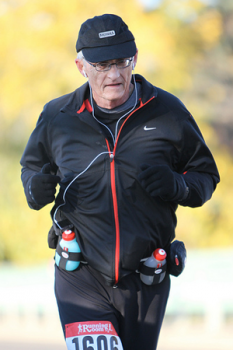 A photo of an elder man jogging