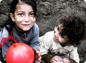A photo of two gypsy children playing