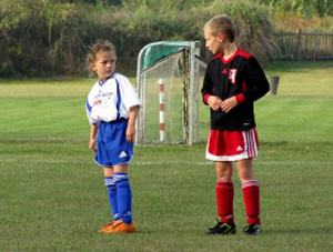 a photo of a boy and girl playing football