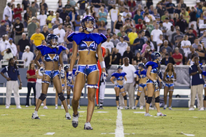 A photo of Women in lingerie playing american football