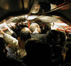 A photo of a busy train carriage