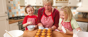 A photo of a mother teaching baking