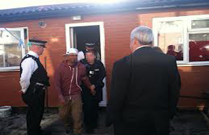 Photo of a Immigration housing raid courtesy of Home Office UK